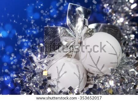 white New Year's balls and tinsel on a blue background
