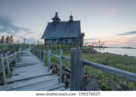 White night on the shore of the White Sea, Northern Russia. The village Rabochestrovsk (town of Kem) - view of the church - stock photo