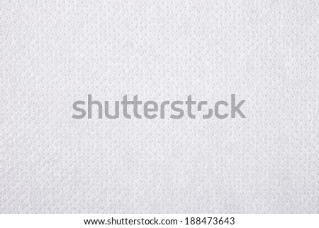 White nonwoven fabric as background texture - stock photo