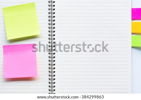 White note paper bookmark with sticker note on book lined pages. - stock photo
