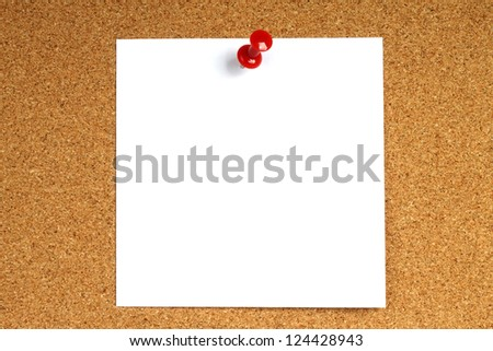 White note with pin on wooden background - stock photo