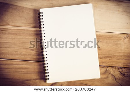 White notebooks laying on a wooden table - still life - stock photo