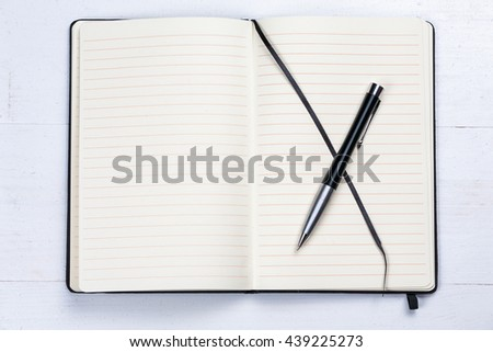 White notepad notebook lines elegant pen grey wooden background  - stock photo