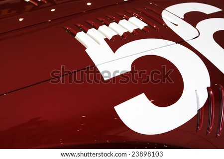white number 56 of red old sport car - stock photo