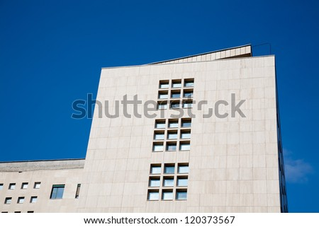 white office building over blue sky - stock photo