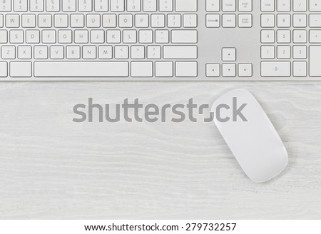 White office table with computer keyboard and mouse. Top view with plenty of copy space.  - stock photo