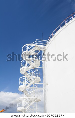White oil reservoir. Oil and gas refinery plant. Industrial scene of oil field. Gas station - stock photo