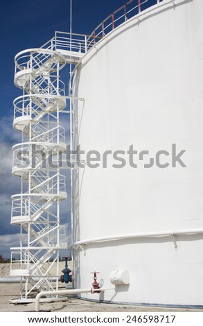 White oil reservoir. Oil industry and gas refinery plant. Industrial scene of oil field - stock photo