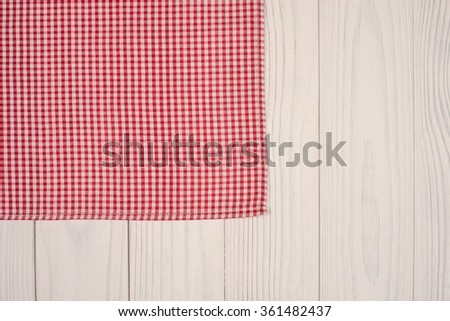white old vintage wooden table with red checker napkin - stock photo