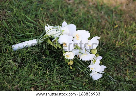 White orchid wedding bouquet. - stock photo