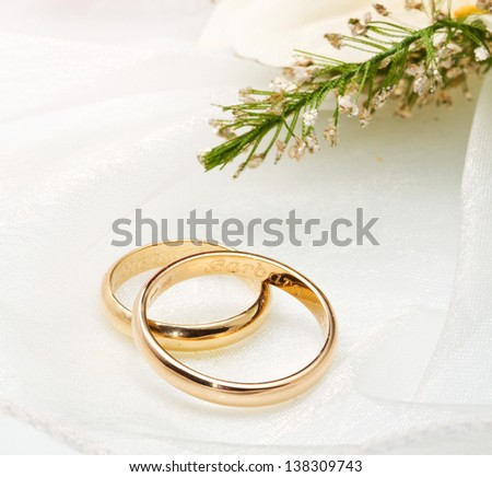 white orchids and pink rose and wedding rings on white background - stock photo
