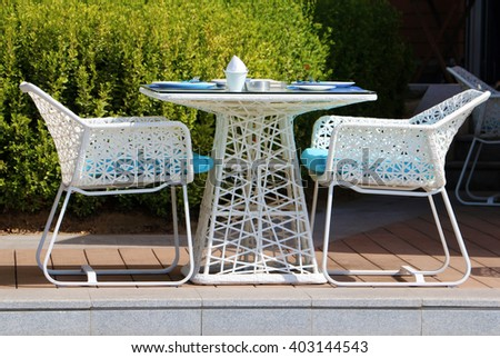 white outdoor restaurant seating for two people - stock photo