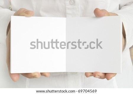 white page in hands - stock photo
