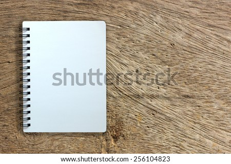 white page of notebook on wood texture background - stock photo