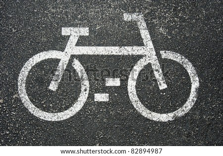 White painted sign for bikes on asphalt - stock photo