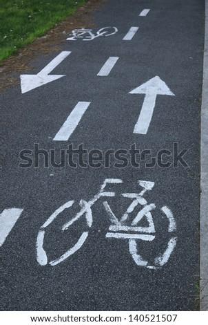 White painted symbol for bike lane - stock photo