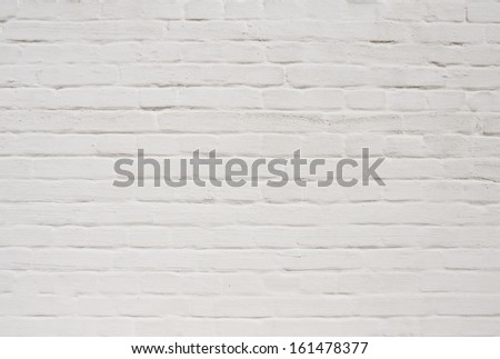 White painted weathered brick wall background. May be used for graffiti - stock photo