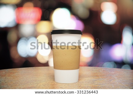 White paper cup of coffee to go on the wooden table, mock up - stock photo