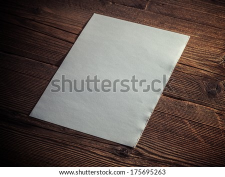 White paper on wood background - stock photo