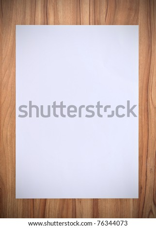 White paper on wood table - stock photo
