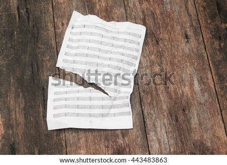 white paper sheet note rip and crumpled on a wooden floor soft-focus  with copy space for add text above and may be used as background  - stock photo