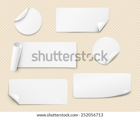 White paper stickers of various shapes with twisted angles - stock photo
