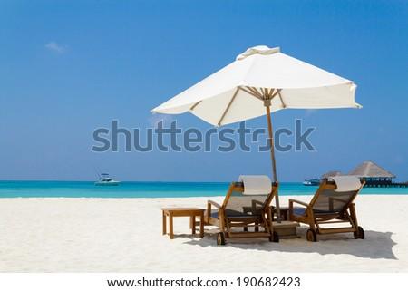 White parasol and beautiful beach,Maldives - stock photo