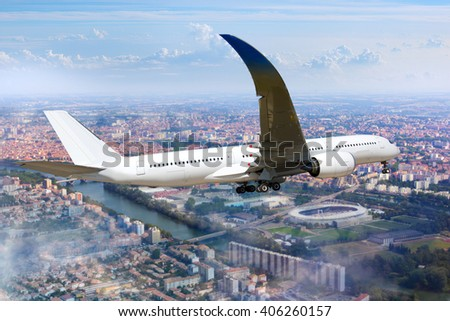 White passenger wide-body aircraft is flying in the cloudy sky, over the over city residential areas, the river and the stadium - stock photo