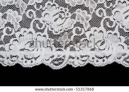 White pattern lace insulated on black background - stock photo