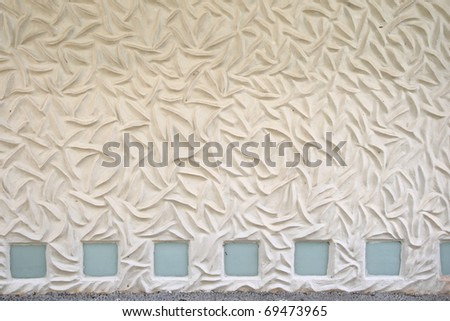 white patterned mortar wall with glass block decoration - stock photo