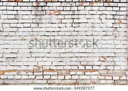 White peeled brick wall texture background.  - stock photo