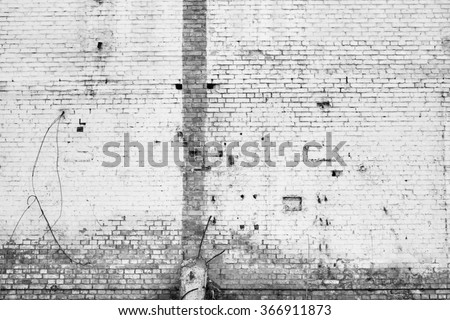 White peeled broken brick wall texture background. Vintage effect. Cold winter theme.  - stock photo