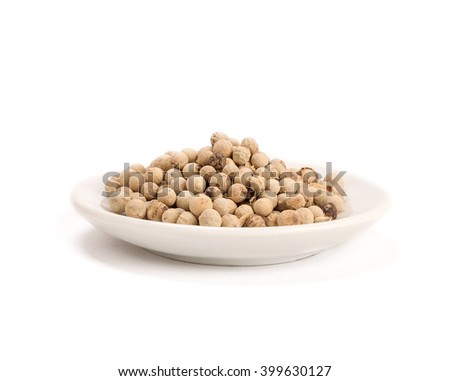 white peppers in white bowl on the white background - stock photo