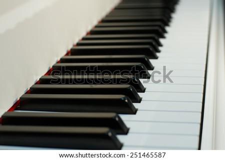 white piano keys on the diagonal - stock photo