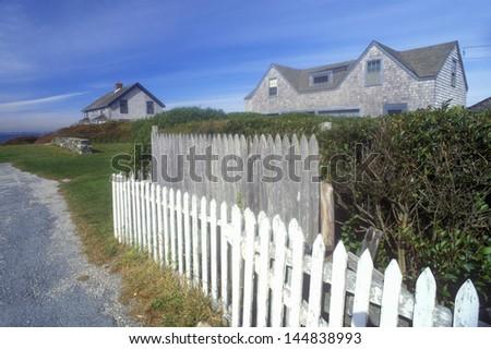 White picket fence along Route 77 in Sakonnet, RI - stock photo