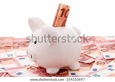 White piggy bank with euro bills over a white background - stock photo
