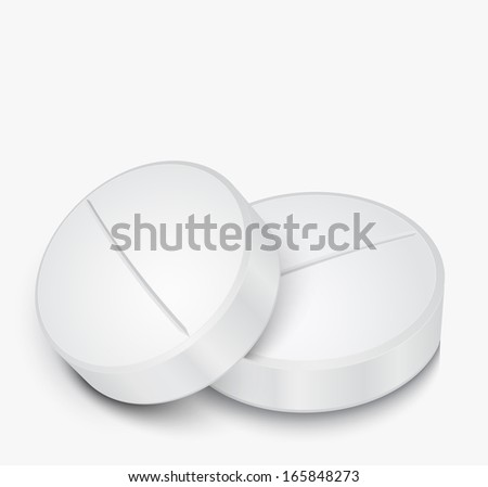 White Pill on gray background  - stock photo