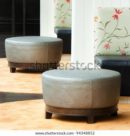 White pillow and sofa. - stock photo