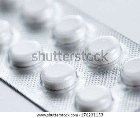 White pills in blister pack,shallow depth of field - stock photo