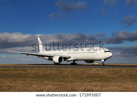 White plane after landing at the airport on a blue sky with beautiful clouds - stock photo