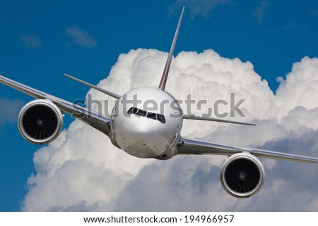 White plane from the front flying in the air - stock photo