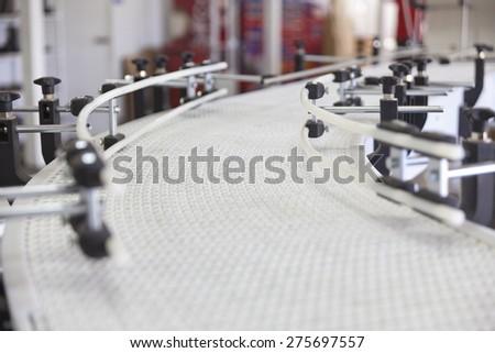 white plastic conveyor in  industry - stock photo