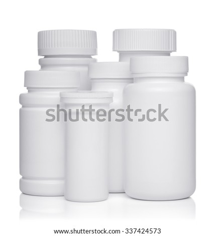 white plastic medical containers for pills isolated on white background - stock photo