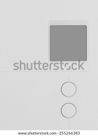 White plastic thermostat with blank LCD screen and 2 buttons - stock photo