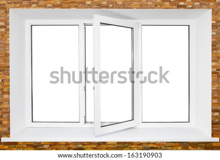 White plastic triple door window on brick wall with cutout area inside - stock photo