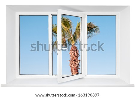 White plastic triple door window with palm tree on blue sky through glass. Isolated on white background. Opened door - stock photo