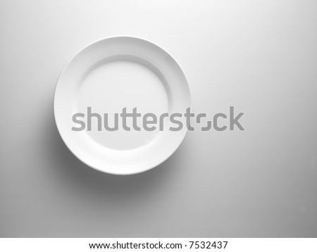 white plate on a white surface - stock photo