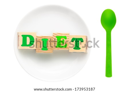 White plate with green word diet composed of wooden blocks and green spoon. Isolated on a white background. Dieting concept - stock photo