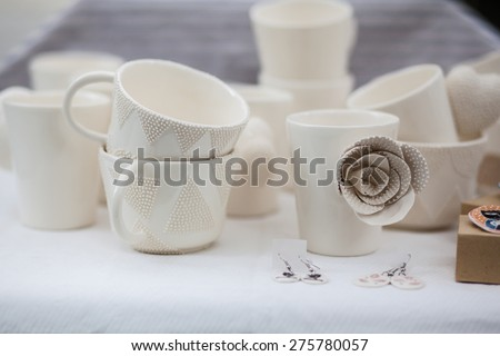 White porcelain cups with different decoration - stock photo