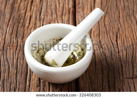 white porcelain mortar and pestle - stock photo
